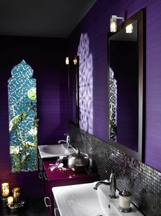 Love the Moroccan bohemian vibe of this bathroom.  Everything from the rich purple walls, to the iron scroll work to the tiled back splash and double vanity.