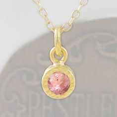 Pink Tourmaline Birthstone Gold Necklace - Simple elegant and full of class this 18k Gold plated silver solitaire necklace features a stunning blush pink Tourmaline Gemstone set into a textured surround. #Embersjewellery #Jewellery #Special #Stone