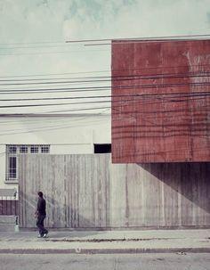Rusted steel + concrete  Administration Curricular Building Liceo María Auxiliadora de Linares by Surco Studio