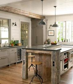 love the barn wood on this kitchen island - and beam