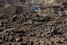 Knoll Ridge Cafe, Whakapapa Ski Field, Tongariro National Park. With COLORSTEEL® roof in Ironsand.  Architecture by Harris Butt Architecture. Photography by Simon Devitt.