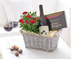 Luxury Chocolates and Red Wine Gift Basket: Why not send a gift of pure luxury to make them feel special? This delightful gift basket is all about spoiling them – with a glass or two of smooth red, a selection of delicious chocolates, and an array of red roses. What more could they want?