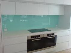 kitchen aqua glass splashback - I still absolutely LOVE these--easy to clean, without recaulking or grouting issues. Seems like this would be beautiful, practical, and sustainable. Wonder what splashes might look like or if it shows streaks?