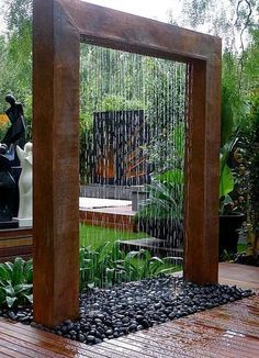 Created from rusted steel, this contemporary water feature will be a focal point of the garden.