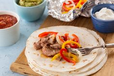Marinated steak strips and flavorful veggies make a delicious fajita filling--perfect for busy weeknight dinners. Mexican Food Recipes, New Recipes, Dinner Recipes, Cooking Recipes, Ethnic Recipes, Wrap Recipes, Favorite Recipes, Dinner Ideas, Supper Ideas