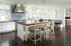 white kitchen, vaulted ceiling, all windows