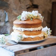 Naked Wedding Cake - simple and classic with some fresh flowers for decoration