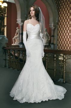 Alencon and venice lace fit and flare features a sweetheart neckline and regal satin criss-cross cummberbund at the waist. Justin Alexander, 2014