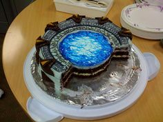 leslie_v: Stargate cake I made for Evan's birthday. Chocolate devil's food, with mint white chocolate ganache, buttercream and homemade mint marshmallow.