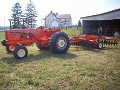 Allis CHalmers WC tractor hooked to orange 3 bottom plow ...