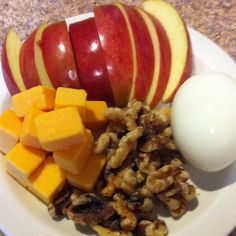 Healthy Breakfast... Apple, cheese cubes, walnuts, hard boiled egg