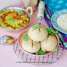 Herbivore Cucina: Masala Baati...Rajasthani Masala Baati, whole wheat balls stuffed with spiced peas potato mixture, baked and served with spicy dal and sweet churma