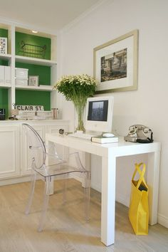 Love the painted inner shelves. Create a small office area in your space and keep it light with white and l  Clear accessories and chair. All white + color in built ins