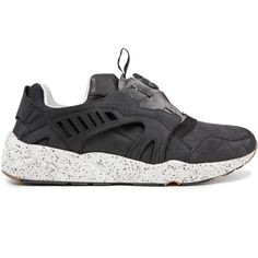 Trinomic Disc NC Black by Puma for the season Autumn Winter 2014The Puma Disc Trinomic N Calm is designed with different materials including suede and textile with an interesting texture. This black upper is reminiscent collaboration Sophia Chang x Puma Disc Blaze Trinomic but this time, the midsole is white dotted with black paint, coupled with a gum outsole.- Color: Black- Style: 357038 01- Speckled outsole