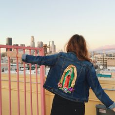 ON BACK ORDER: Due to a high demand, we will not be sending out orders until after 11/28. Feel free to place an order to secure your jacket, but please note that orders will not be mailed out until after 11/28. Gracias! ABOUT THE JACKET: Need protection? We've got your back. Hija de tu Madre's Virgencita Denim Jacket features a fitted denim jacket silhouette and a multicolor sequin appliqué of La Virgen de Guadalupe on the back. Model is wearing a Medium *Sequin applique detail *Copper...