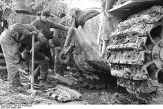"A German Panzer VI ""Tiger I"" crew replacing a damaged track in Italy."