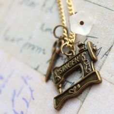 Singer Sewing Machine Charm Necklace by outoftheblue on Etsy, $16.00