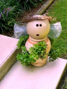 garden angel made from a bowling ball  THIS IS JUST TO CUTE NOT TO PIN.!!!!! HA,  NOW WHERE DID I PUT THAT BOWLING BALL