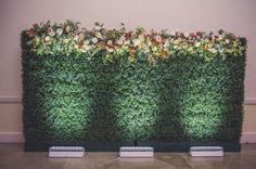 Boxwood hedge floral covered backdrop wedding @ohekacastle @caratsandcake oheka castle wedding flower wall