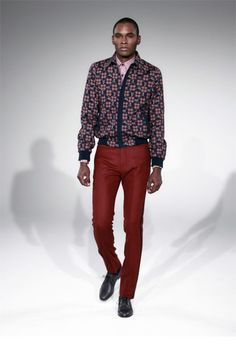 Slim tailored suits, blazers, and wool coats set the tone for Carlos Campos' Fall 2013 collection. Blue and burgundy dominate the color palette, while close fitted leather jackets help add a little attitude....
