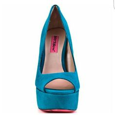 "Super Sext Betsey Johnson Pumps They'll see your sexy strut a mile away in these hot heels from Betsey Johnson. Sita has a luxe teal leather/suede upper with a lace up design in the back heel. Approximately  5 1/2"" heel accented with a 1 3/4"" platform. You will turn heads in these heels. Size 9M. Gently used. A few nicks inside the inside sole (as pictured above ) but the outer portion of the shoe is in good condition. Betsey Johnson Shoes Platforms"