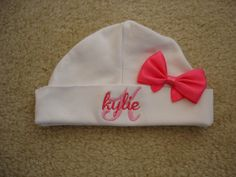 Custom personalized monogrammed personalized name on initial white newborn baby hat with hot pink bow by StitchedbyStephanieP on Etsy https://www.etsy.com/listing/245985564/custom-personalized-monogrammed