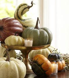 Pumpkins, gourds, candles, pedestal