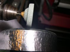 Using a Dremel tool, I first rough up the sharp cut using a Silicon Carbide conical grinding tip. Oh yeah, wear a dust mask, you don't want to be breathing ground glass!  Roughly grind the inside and outside of the edges using the Dremel.