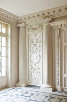 We could do a similar thing (minus pillars) using a ceiling medallion and some wood appliques.