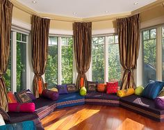 Add color & curtains to open space. Lounge-like living room
