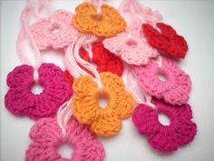 crocheted flowers:  Start with 7 chain, join with slipstich.  5 times (2 chain, 3 double crochet, 2 chain, slipstich).