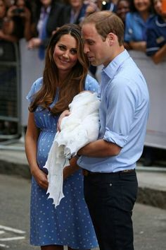 Kate, Will & baby boy. Kate looks very lovingly at Will......