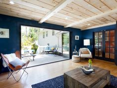 Retractable doors easily open up the living room to the deck, doubling the size of the living space, as seen on HGTV's Cousins Undercover.
