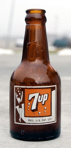 7-up, 1945 I don't remember this bottle.....I was only 3....it is unique.  Looks like a beer bottle.