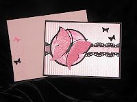 This card is VERY pink but the layout works well in a variety of colors and/or patterns. Large butterfly cut with eCraft electronic cutter using the image SD card that comes standard with the machine. Smaller butterflies cut with Fiskars mini craft punch. Eyelet strip cut with a Martha Stewart Doily Lace double edge punch.