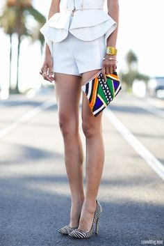 Abstract peplum with a tuxedo short. I love the tribal accents in the clutch and shoes