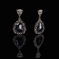 Femme Feline Marquis Noir Earrings  $14 from $24 Express yourself with these sleek sultry earrings featuring sparkling felines with emerald eyes perched on daring black.