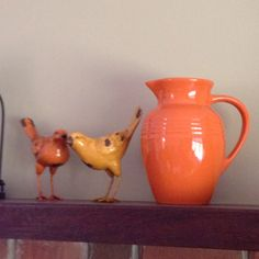Pops of orange on the mantle. Le Creuset pitcher from Marshall's!