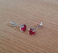 Genuine Ruby stud earrings in solid sterling by TheAladdinsCave