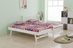 This white single bed frame includes a standard bed and a trundle bed. The trundle bed can be pulled out and raised to the same height as the main bed, when not in use it can be folded away under the main bed to save space. It's ideal for small sized rooms, such as guest rooms, kid's bedroom and so on.