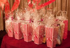 DIY hollywood themed graduation party prizes - popcorn container, dvd, popcorn and candy!