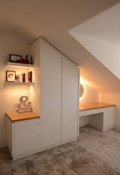 Bedroom eve storage area with wardrobe & desk/dressing table.