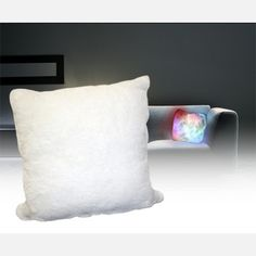 It's a moonlight cushion!! An inner light source provides a trippy light show for the whole room. I want one of these ASAP.