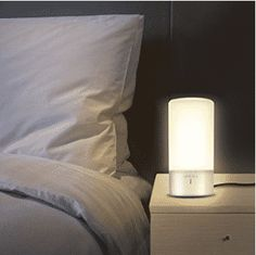 LiliLite reading lamp: the ultimate bed lamp for readers. A bookshelf, reading light and bookmark combined into one smart product. The book sensor turns the light on or off automatically. Touch Table Lamps, Touch Lamp, Pottery Barn, Book Lamp, Nightstand Lamp, Large Lamps, Bedside Lighting, Desk Light, Lamp Light