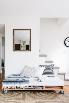 An airy Minnesota home decorated with homemade furniture, lush plants and children's artwork. Find Furniture, Furniture For Small Spaces, Pallet Furniture, Pallet Daybed, Diy Daybed, Storage Daybed, Furniture Stores, Kids Pallet Bed, Furniture Ideas