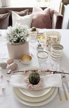 Pink and white Easter table setting/tablescape with pink cherry branches, moss eggs and white Campanula. http://anettewillemine.blogspot.no/