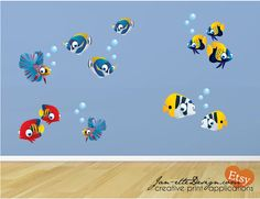 Brightly Colored Tropical Fish to add to you Ocean Theme Room!  Printed on peel and stick polyester adhesive backed fabric that can be installed on