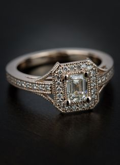 Stunning detail in this Vintage Milgrain Emerald Halo Diamond Ring in Rose Gold. What a beautiful ring!