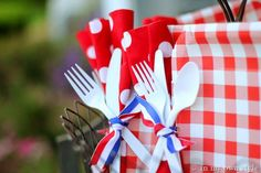 Punch hole in paper plate - push ribbon thru hole - tie napkin & flatware to plate. Easy for guest to carry together...