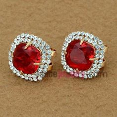 Delicate stud earrings with rhinestone and red crystal decoration